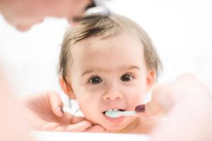 Baby getting teeth brushed